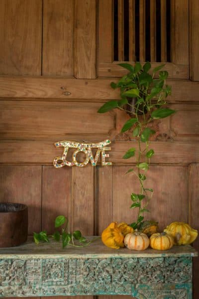 the word love made from a wooden sign with glitter and mirror
