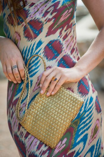 Long slip dress with a gold purse