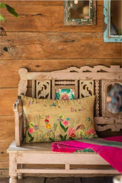 rectangular linen cushion with colourful floral embroidery and Follow Your Dreams written on it