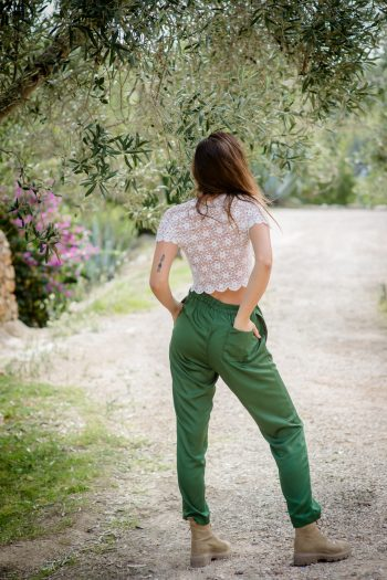 green trousers with a white lace top