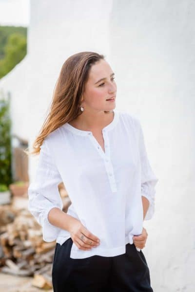 white cotton top with long sleeves and elasticated cuffs