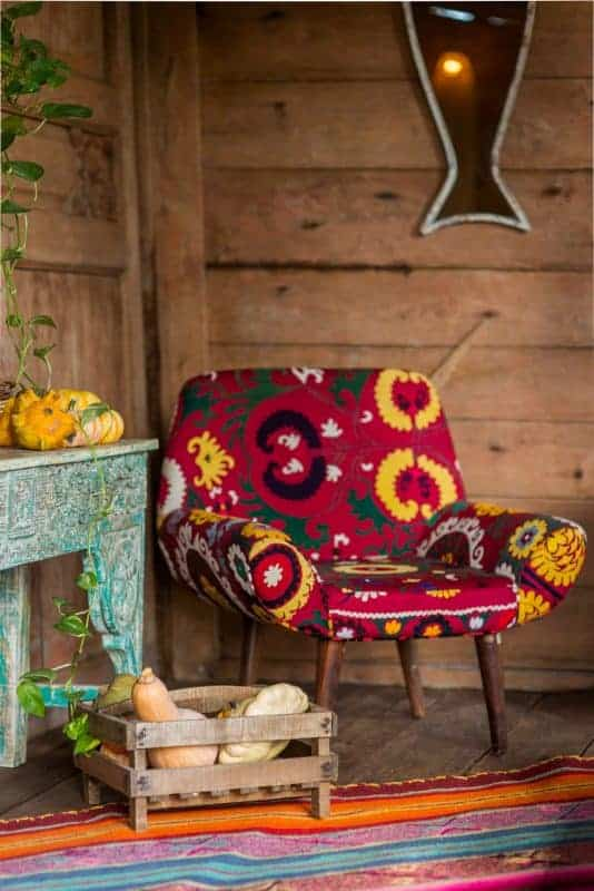armchair upholstered in red embroidered Suzanni fabric