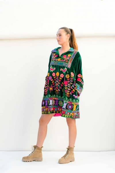 green velvet dress with pockets and colourful embroidery