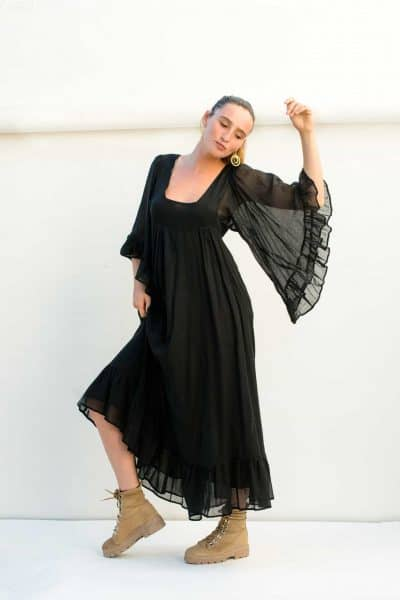 oversized butterfly sleeves on a black cotton dress