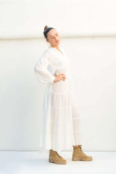 side view of a long white button up dress