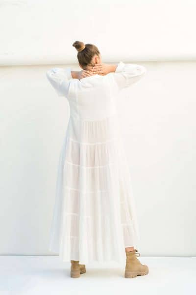 back view of a long white dress with frilled cuffs