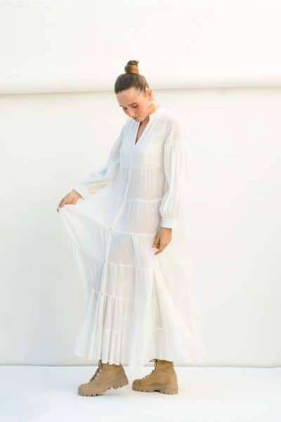 Tiered white dress with long sleeves and pockets