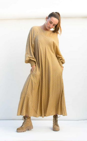 yellow print midi length dress with long sleeves and pockets