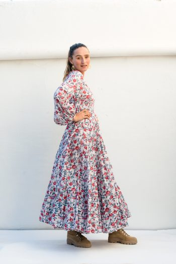 long white dress with red flowers and long sleeves