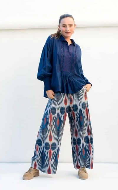 blue blouse with ikaat print trousers