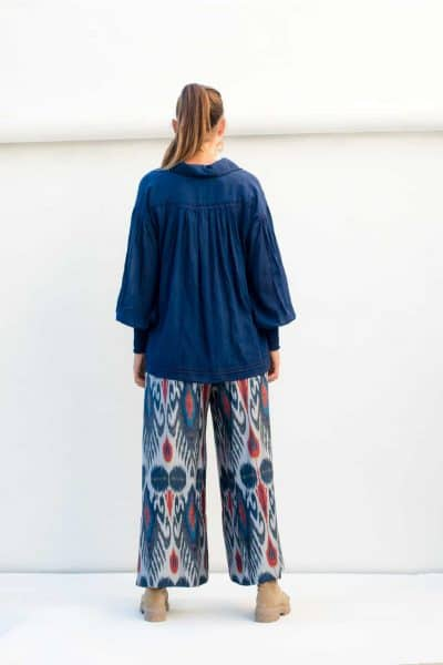 indigo ikat print trousers and a navy blouse