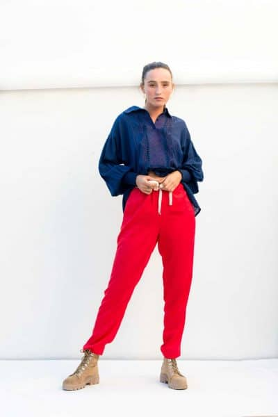 loose red trousers with a navy top