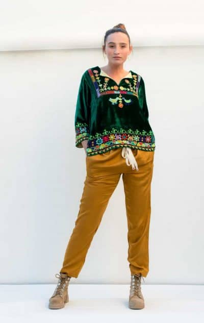 long trousers in a mustard colour paired with a velvet top in brown