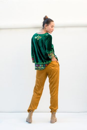 mustard trousers and a short velvet top
