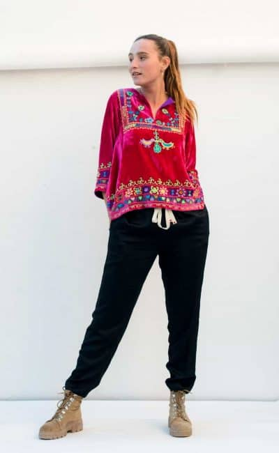 pink velvet top with black trousers