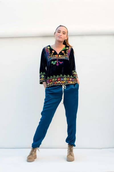 navy velvet top with blue trousers