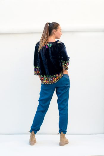 navy velvet top with blue casual trousers