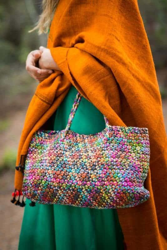 multicoloured leather bag with orange scarf