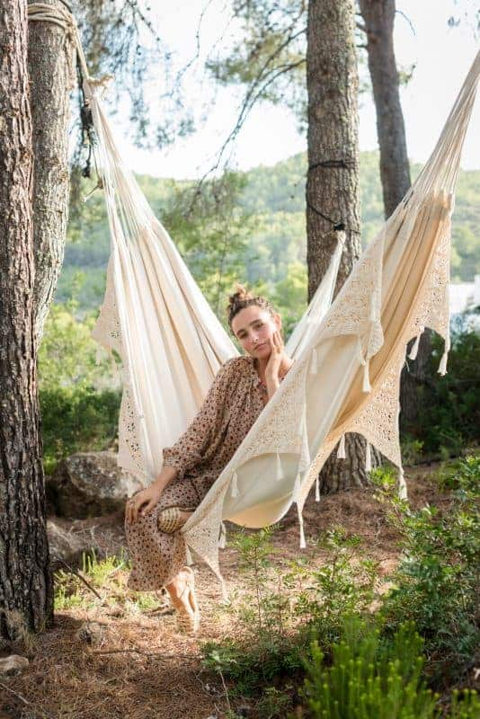 Lounging in a hammock in the forest