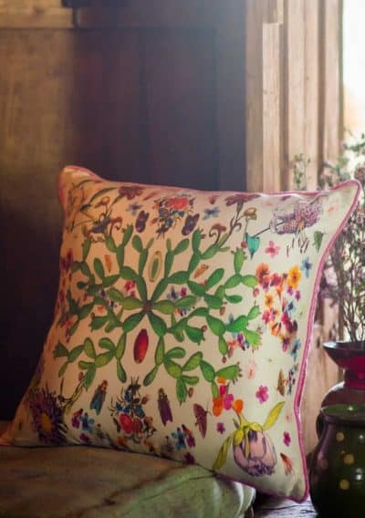 Silk screen print botanical cushion with a cactus scene on it