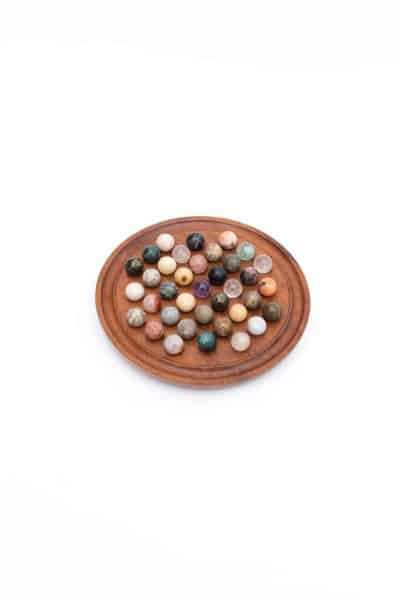 round solitaire board game with crystal balls medium