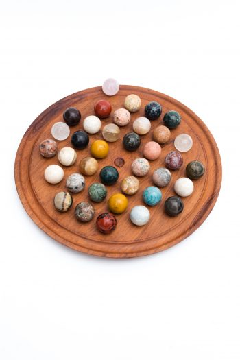 large round solitaire board game with colourful crystal balls