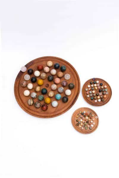Round solitaire board games with crystal balls