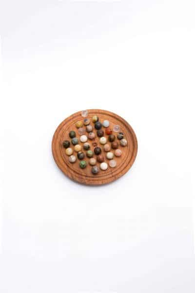 small sized round solitaire board game with crystal balls