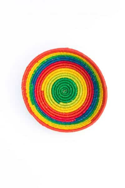 round basket from Madagascar in rainbow colours