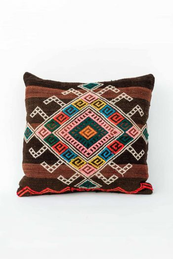 geometric embroidered pattern on a square cushion