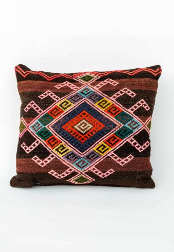 striped cushion with a geometric pattern on it
