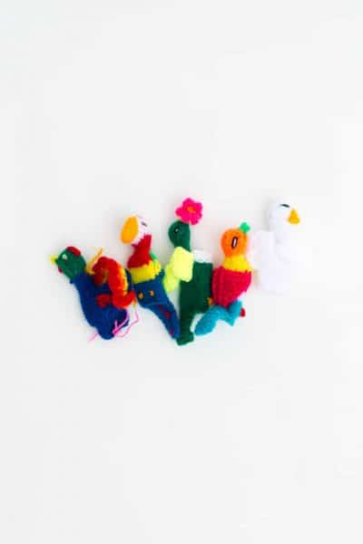 hand knitted bird finger puppets in bright colours