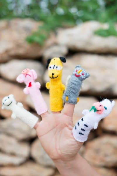 Hand knitted finger puppets in animal shapes