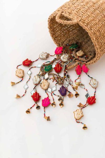 Decorative cloth garland with Hamsa hands, kite mirrors and bells