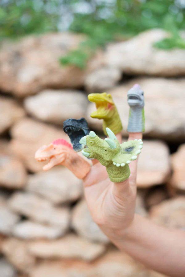 Dinosaur finger puppets on five fingers