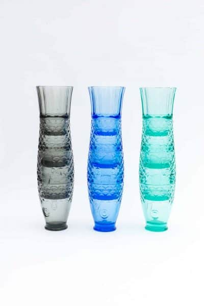 stacked glasses in blue, grey and turquoise in the shape of a fish
