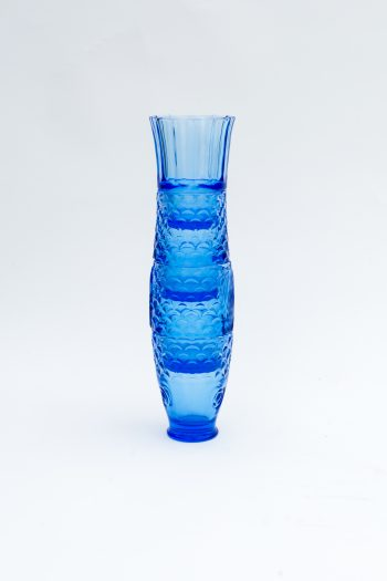stacked blue drinking glasses to form the shape of a fish