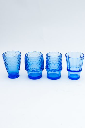 blue drinking glasses in a line