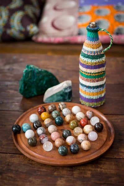 Round wooden solitaire game with crystals