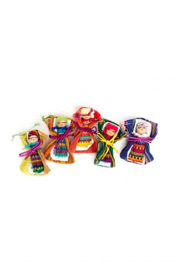 Colourful dolls sleeping on Guatemalan fabric