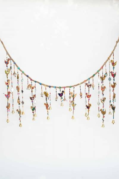 Hanging garland with white birds and beads