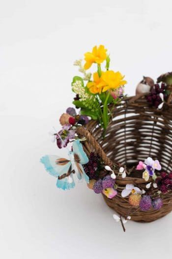 hand decorated basket with flowers, birds and butterflies