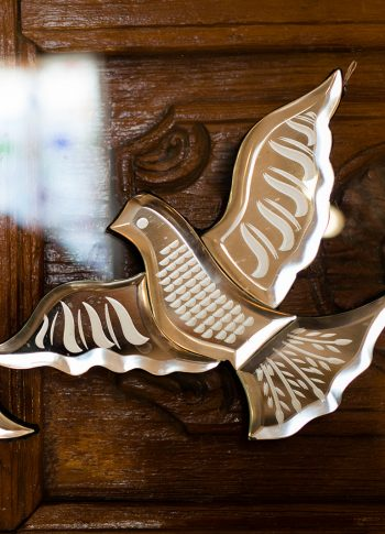 small mirror in the shape of a dove in flight