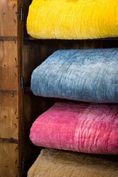 Folded velvet bedspreads