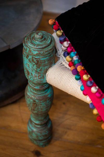 Silk ball trim on a velvet blanket