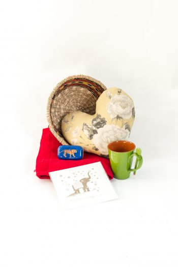 wicker basket with heart cushion, soap, mug, scarf and greetings card