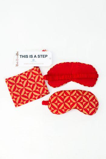 red geometric print silk eye mask with matching bag