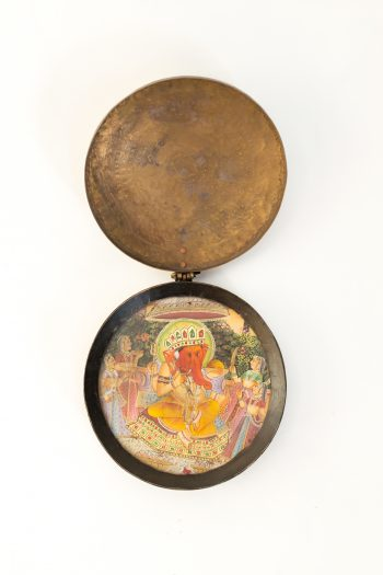 portable brass shrine with Ganesha painted on glass
