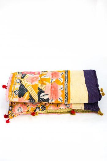 multicoloured floor mattress with tassels