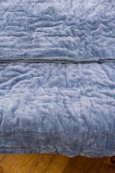 folded powder blue bedspread